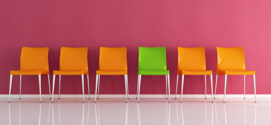 series of plastic chairs against red wall -rendering
