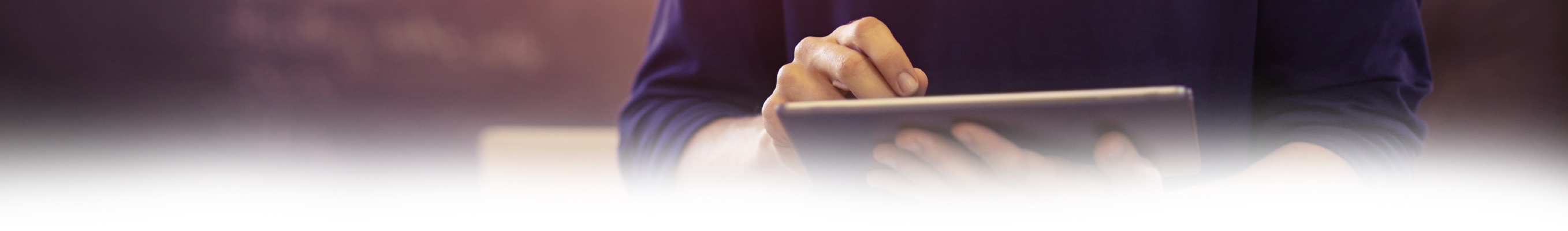 Cropped shot of a young man using a digital tablet